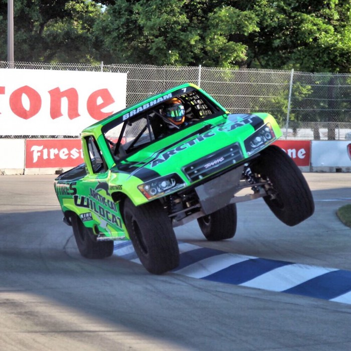 Matty Brabham hiking the Stadium Super Truck wheel in Detroit en route to victory
